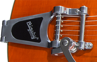 detail image of Gretsch G5622T showing Bigsby B70 vibrato tailpiece
