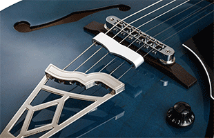 detail image of Vox Giulietta VGA-3D showing piezo-equipped Tune-o-matic bridge with patent-pending string mute