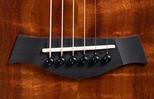 detail image of Taylor GS Mini-e Koa Plus showing bridge saddle