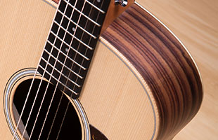 close-up view from above of Taylor GS Mini-e Rosewood showing non-cutaway design