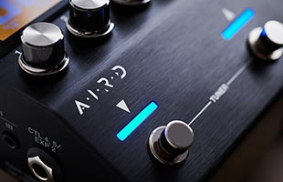 detail image of Boss GT-1000CORE panel showing AIRD logo above stomp switch