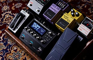 close-up view from above of Boss GT-1000CORE on guitar pedalboard surrounded by expression pedal, footswitch, tuner and other pedals