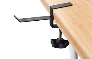 side view of Gator Frameworks Headphone Hanger for Desks clamped to wooden surface