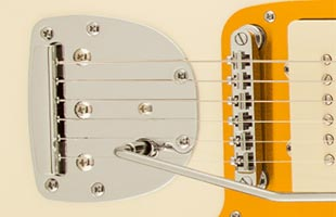 detail image of Squier J Mascis Jazzmaster showing Adjusto-matic bridge with floating tremolo tailpiece