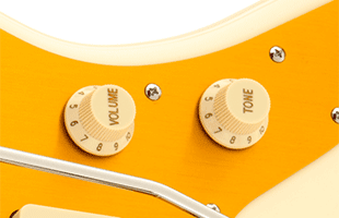 detail image of Squier J Mascis Jazzmaster showing aged white control knobs