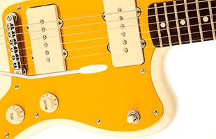 detail image of Squier J Mascis Jazzmaster showing gold anodized aluminum pickguard