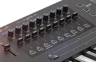 detail image from Kurzweil K2700 control panel showing bank of assignable sliders, knobs and buttons