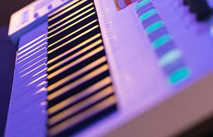 stylish sideways closeup of Arturia KeyStep Pro focusing on keybed