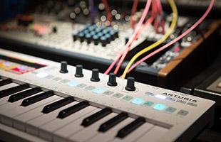 image of Arturia KeyStep Pro connected to eurorack modular synthesizer