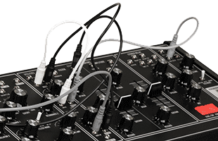 detail image of Moog Matriarch Dark top panel with several patch cables connected