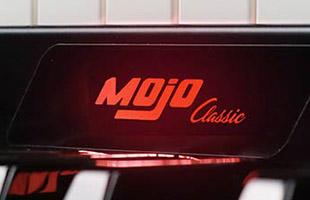 detail image of Crumar Mojo Classic front panel showing internally lit Mojo Classic logo badge