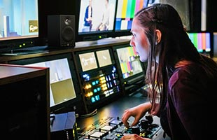 video editor in editing suite equipped with Yamaha MSP3A