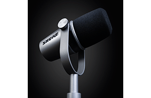 left side view of Shure MV7 with integrated yoke in stand position