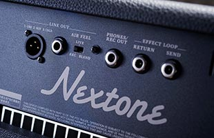 detail image of Boss Nextone Special guitar amplifier rear panel showing audio connections