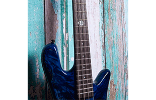detail view of Spector NS Ethos 4 fretboard showing 12th fret Spector logo inlay