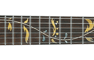 detail image of Ibanez PIA3761 Onyx Black fretboard showing PIA Blossom inlay