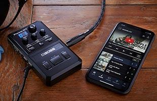 Boss Pocket GT sitting alongside smartphone running Boss Tone Studio app