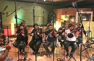 Istanbul Strings string ensemble performing in recording studio