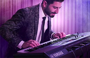 musician performing on stage with Yamaha PSR-A5000