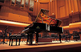Yamaha grand piano on stage in concert hall