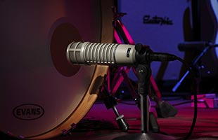 close-up image of Electro-Voice RE20 positioned for recording in front of kick drum