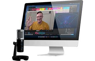 PreSonus Revelator microphone in front of desktop computer showing videoconferencing software on screen