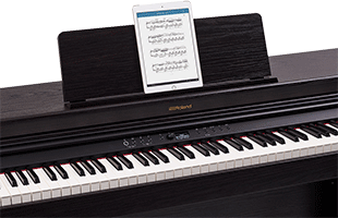 Roland RP701 with Bluetooth-connected tablet computer on music rest