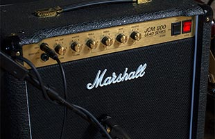 close-up image of Marshall SC20C front with microphone on stand positioned in front of speaker