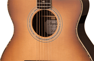 close-up image of PRS SE A54E body showing solid spruce top and ovangkol sides