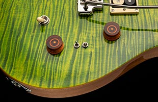 detail image of PRS SE Custom 24-08 showing mini-toggle coil tap switches