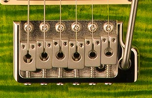 detail image of PRS SE Custom 24-08 showing molded tremolo bridge