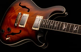 close-up image of PRS SE Hollowbody Standard showing mahogany body and hollow construction