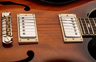 close-up image of PRS SE Hollowbody Standard body showing PRS 58/15 S pickups