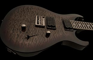 close-up top image of PRS SE Mark Holcomb body showing quilted maple veneer