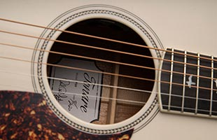 detail image of PRS SE P20E showing soundhole with Fishman Sonitone GT1 preamp mounted inside