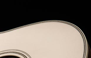 detail image of PRS SE P20E showing herringbone body accent and soundhole rosette