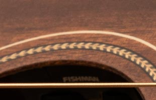 detail image of PRS SE P20E showing soundhole-mounted Fishman preamp