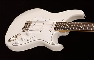 close-up front view of PRS Silver Sky showing body and portion of fingerboard