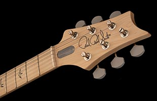 detail top view of PRS Silver Sky showing headstock and portion of fingerboard