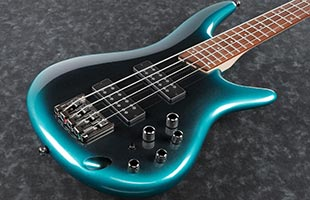 close-up perspective view of Ibanez SR300E showing top and right side of body and portion of fingerboard