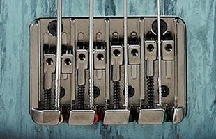 detail image of Ibanez SR300E showing Accu-cast B120 series bridge