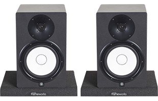 front view of studio monitors resting on Gator Frameworks GFW-ISOPAD-LG Studio Monitor Isolation Pads – Large with pads configured flat