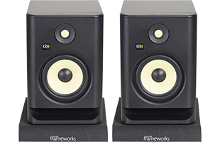 front view of studio monitors resting on Gator Frameworks GFW-ISOPAD-MD Studio Monitor Isolation Pads – Medium with pads configured flat