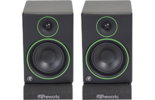 front view of studio monitors resting on Gator Frameworks GFW-ISOPAD-SM Studio Monitor Isolation Pads – Small with pads configured flat
