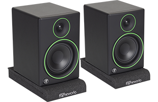 perspective view of studio monitors resting on Gator Frameworks GFW-ISOPAD-SM Studio Monitor Isolation Pads – Small with pads configured flat