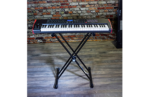 perspective view of keyboard resting on Quik Lok T-20 keyboard stand showing top and front
