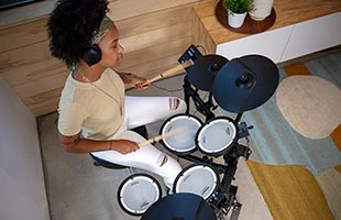 overhead view of drummer playing Roland TD-07KV in living room