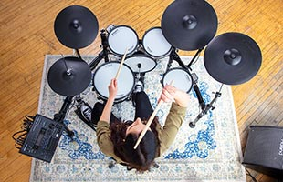 overhead view of drummer playing Roland TD-50K2 in practice space