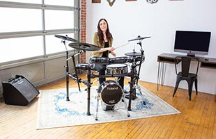front view of drummer playing Roland TD-50K2 in practice space