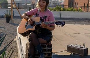 guitarist practicing on rooftop with Yamaha THR30IIA Wireless